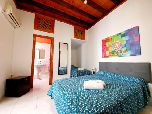 A bed or beds in a room at ARC House Cordoba