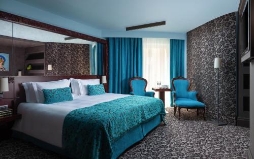 Кровать или кровати в номере Domina St.Petersburg