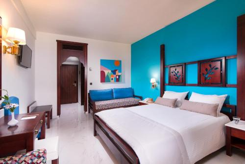 A bed or beds in a room at GHotels Simantro Beach