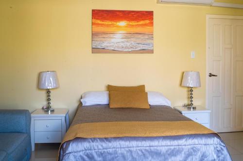 Cama ou camas em um quarto em Juanedu Suites