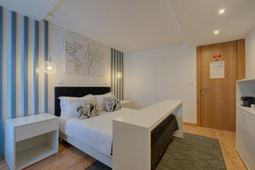 A bed or beds in a room at PR Suites