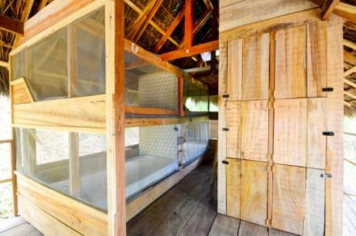 A bunk bed or bunk beds in a room at Hostal Casa Loma Minca