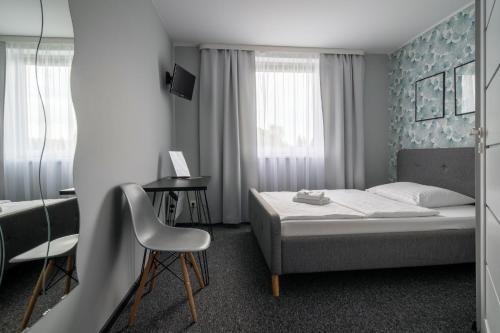 Łóżko lub łóżka w pokoju w obiekcie Nowotel Stop and Sleep
