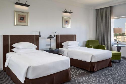 A bed or beds in a room at Hyatt Regency Baku