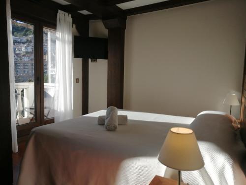 Cama o camas de una habitación en Hostal El Cerro - Only Adults