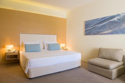 Кровать или кровати в номере Capo Bay Hotel
