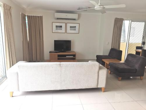 A television and/or entertainment center at DB Broadbeach Private Apartments with Coastal Holiday Apts