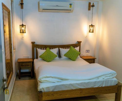 A bed or beds in a room at Moustache Agra