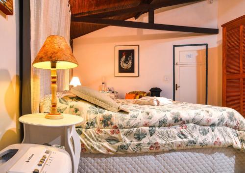 Cama ou camas em um quarto em Pouso Caminho das Artes