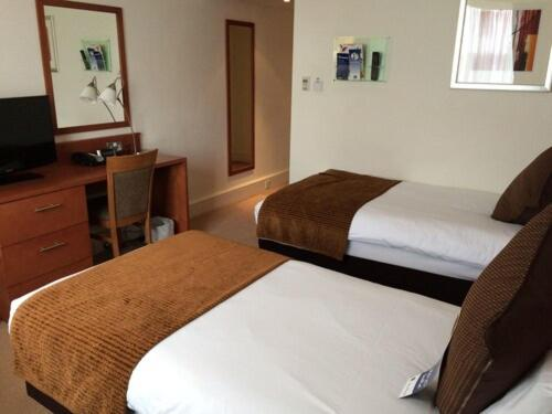 A bed or beds in a room at DoubleTree by Hilton Reading M4 J10, an Hilton hotel