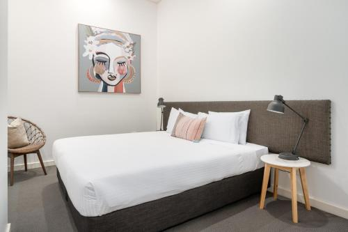 A bed or beds in a room at Terminus Apartment Hotel (formerly Quality Apartments City Centre Newcastle)