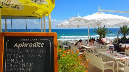 A restaurant or other place to eat at Aphrodite Beach Hotel