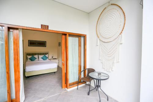 A bed or beds in a room at La Cecile Hotel & Cafe Komodo