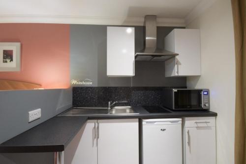 A kitchen or kitchenette at Telford Whitehouse Studios & Apartments