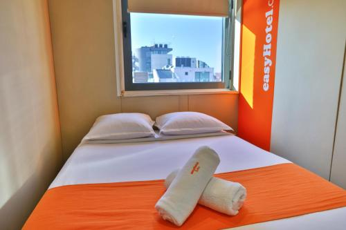 A bed or beds in a room at easyHotel Sofia