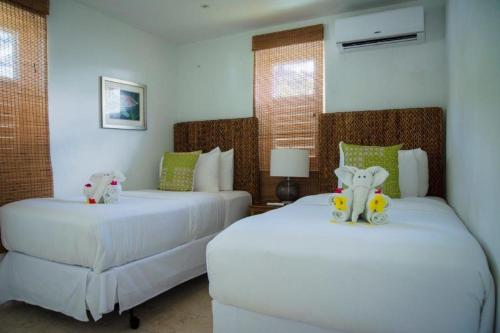 A bed or beds in a room at Bequia Plantation Hotel