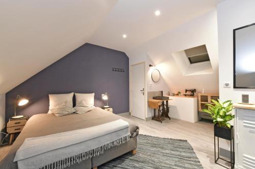 Un ou plusieurs lits dans un hébergement de l'établissement Chambres d'hotes Les Nuits Pastel