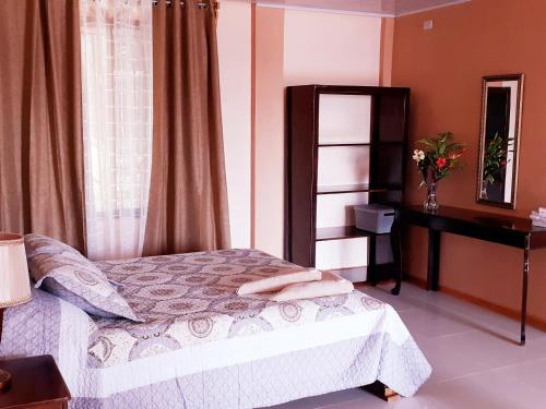 A bed or beds in a room at VILLA MANOLO CORCOVADO, Ocean & Forest view Lodge, Bar & Restaurant