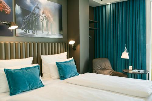 A bed or beds in a room at Motel One Berlin Ku'Damm