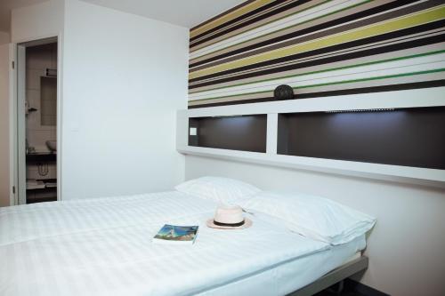 Ein Bett oder Betten in einem Zimmer der Unterkunft My Hotel