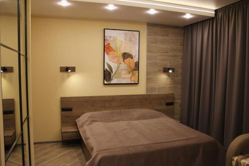 Кровать или кровати в номере Мини-отель Уют