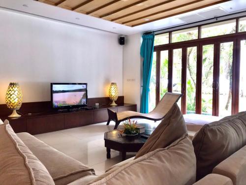 A seating area at Amatapura Beachfront Villa 14, SHA Certified