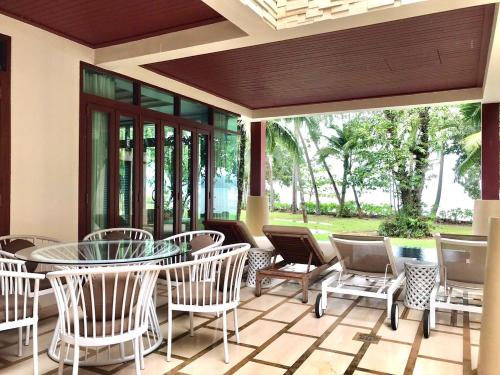 A restaurant or other place to eat at Amatapura Beachfront Villa 14, SHA Certified