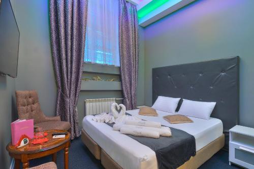 """A bed or beds in a room at Отель """"на Кутузовской"""""""