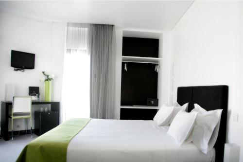 Uma cama ou camas num quarto em Benavente Vila Hotel