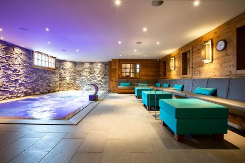 The swimming pool at or near Hôtel Champs Fleuris Morzine