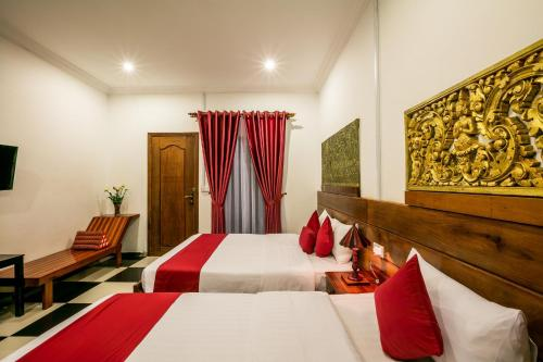 A bed or beds in a room at Asanak D'Angkor Boutique Hotel
