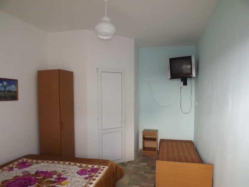 Телевизор и/или развлекательный центр в Guest House Aura