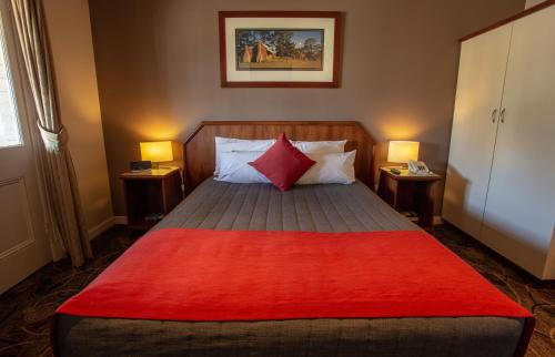 A bed or beds in a room at Quality Hotel Bayswater