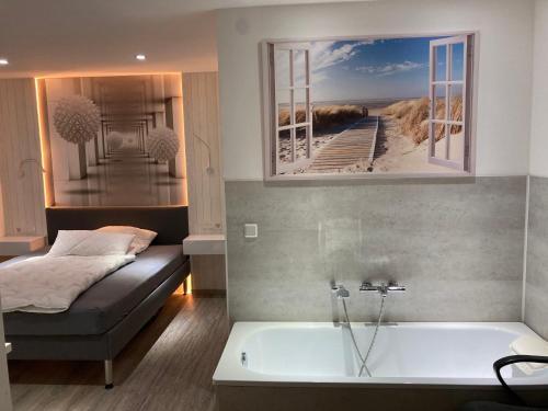 Ein Badezimmer in der Unterkunft Messe-Hotelzimmer-Einzimmerappartement