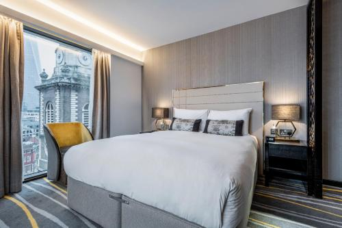 A bed or beds in a room at Dorsett City London