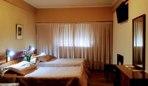 A bed or beds in a room at Hostal Santa Fe De La Veracruz - Habilitado