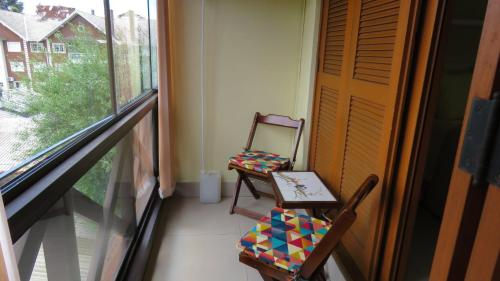 A balcony or terrace at kitnet em Canela