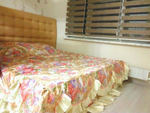 Кровать или кровати в номере Апартаменты в центре Балашихи
