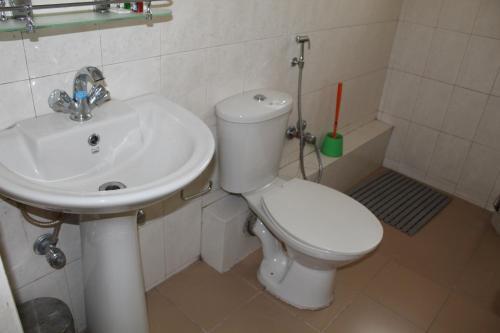 A bathroom at Say Homes Dechen Villa