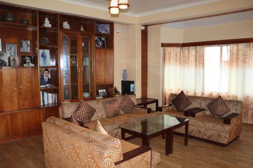 A seating area at Say Homes Dechen Villa