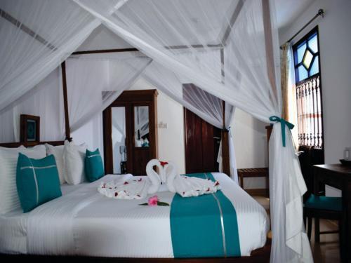 Кровать или кровати в номере Maru Maru Hotel