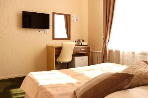 Телевизор и/или развлекательный центр в Отель Медовая
