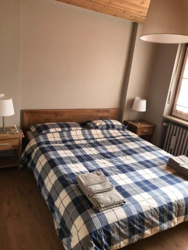 A bed or beds in a room at Bardonecchia Holidays