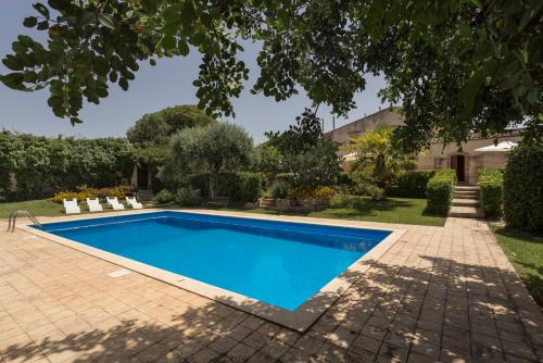 The swimming pool at or near Apartment with 5 bedrooms in Chiaramonte Gulfi with shared pool enclosed garden and WiFi 20 km from the beach