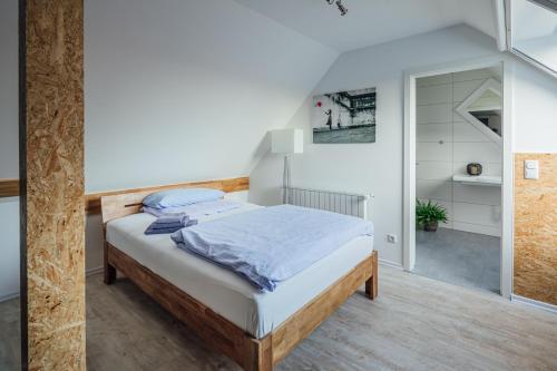 Ein Bett oder Betten in einem Zimmer der Unterkunft Aparthotel Pumpengasse