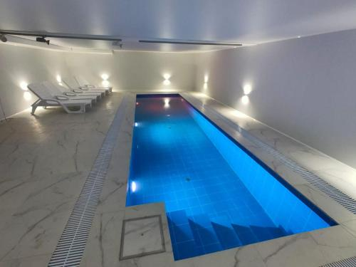 The swimming pool at or close to Luxury modern house with private pier