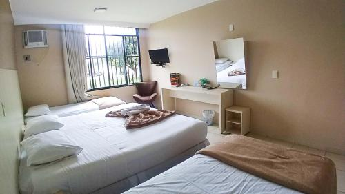 A bed or beds in a room at Hotel Diplomat