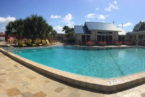 The swimming pool at or close to SureStay Plus by Best Western Orlando International Drive
