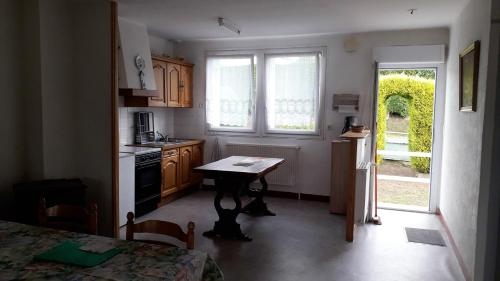 A kitchen or kitchenette at House with 2 bedrooms in LoguivyPlougras with furnished garden 23 km from the beach