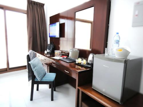 A television and/or entertainment center at Al Jaddaf Star Residence